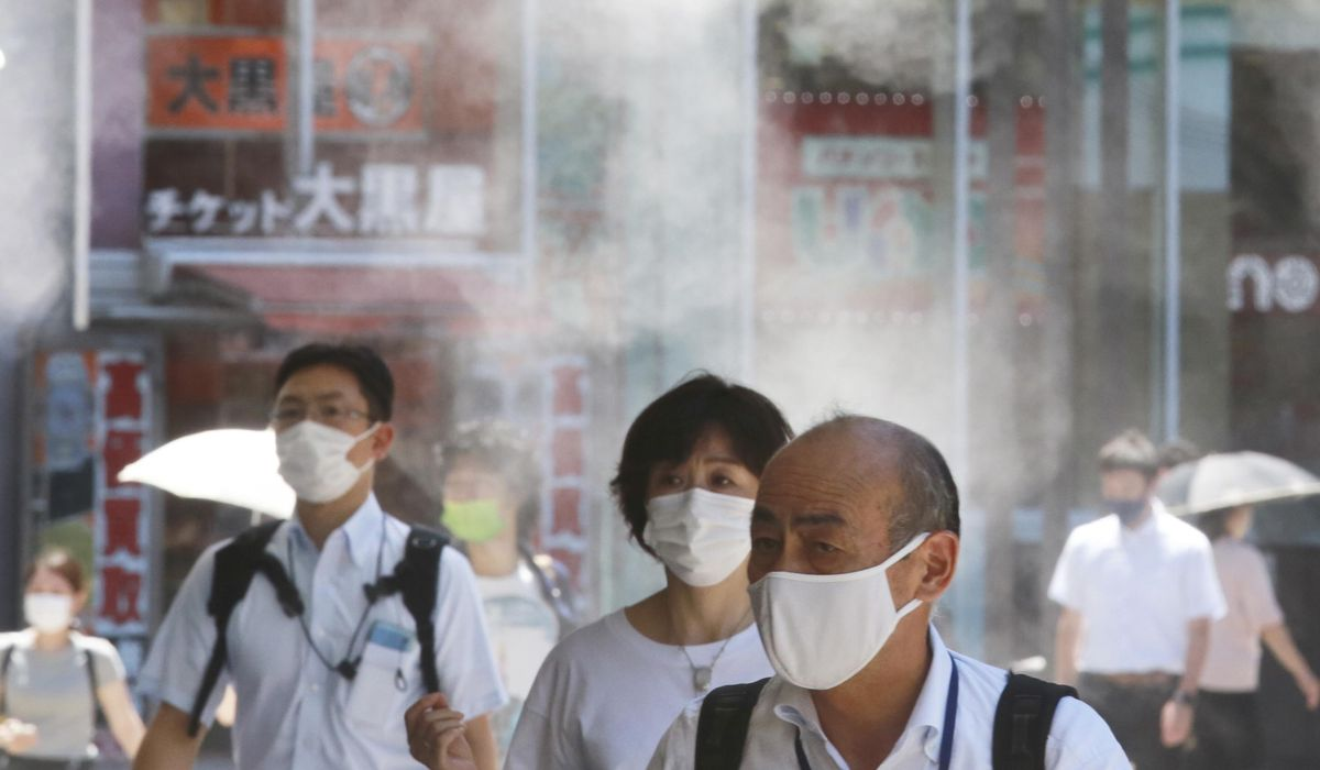 Tokyo logs record 5,042 cases as infections surge amid Olympics