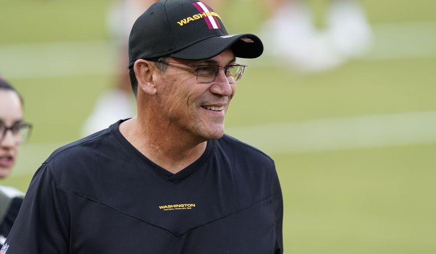 Washington Football Team head coach Ron Rivera smiles during an NFL football practice at FedEx Field, Friday, Aug. 6, 2021, in Landover, Md. (AP Photo/Alex Brandon)