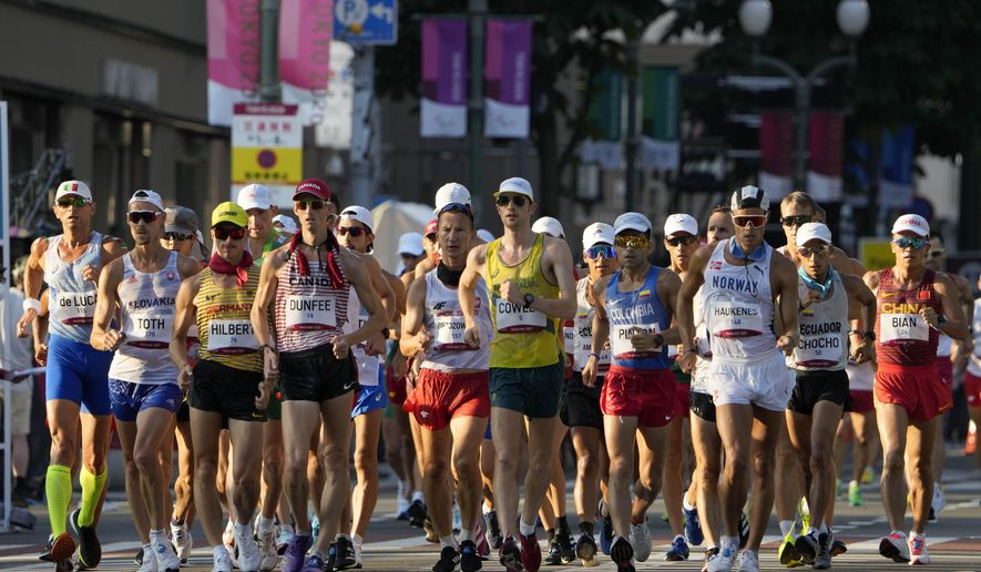 Athletes compete during the men's 50km race walk at the 2020 Summer Olympics, Friday, Aug. 6, 2021, in Sapporo, Japan. (AP Photo/Eugene Hoshiko)