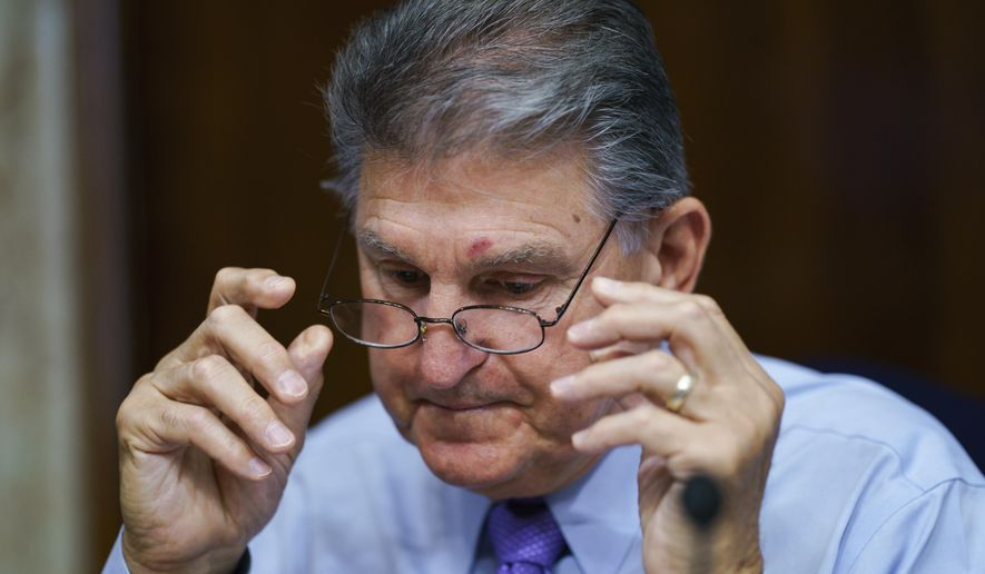 In this Aug. 5, 2021, file photo, Sen. Joe Manchin, D-W.Va., prepares to chair a hearing in the Senate Energy and Natural Resources Committee at the Capitol in Washington. (AP Photo/J. Scott Applewhite) ** FILE **