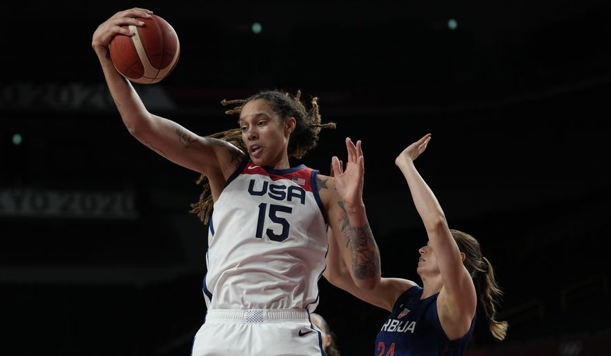 United States' Brittney Griner (15) grabs a rebound ahead of Serbia's Maja Skoric (24) during women's basketball semifinal game at the 2020 Summer Olympics, Friday, Aug. 6, 2021, in Saitama, Japan. (AP Photo/Eric Gay)