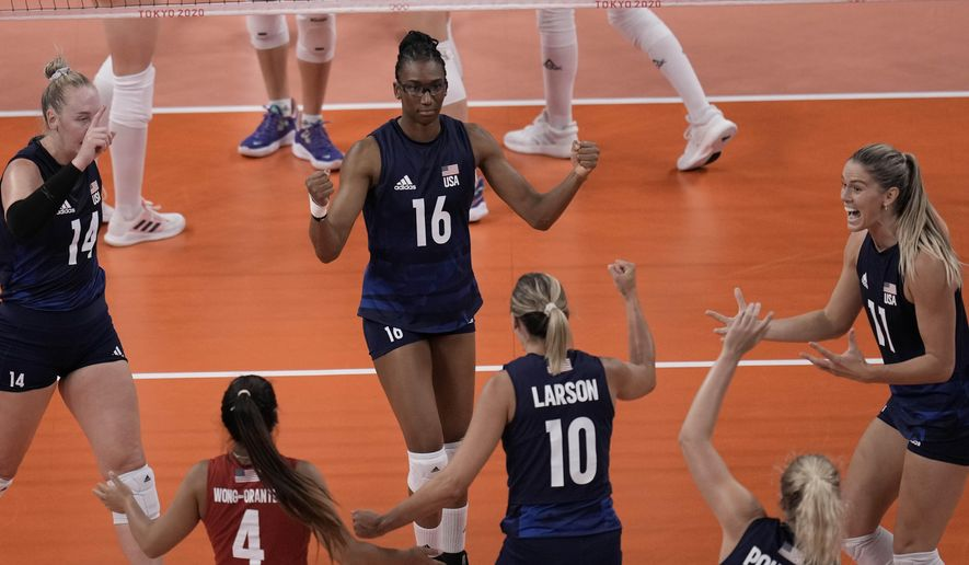 United States players celebrate winning a point during the women's volleyball semifinal match between Serbia and United States at the 2020 Summer Olympics, Friday, Aug. 6, 2021, in Tokyo, Japan. (AP Photo/Manu Fernandez)