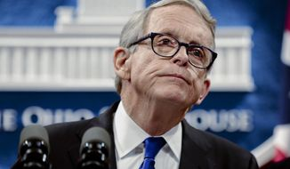 """FILE - In this file photo from Aug. 6, 2019, Ohio Gov. Mike DeWine pauses during a news conference at the Ohio Statehouse in Columbus, Ohio.  After discontinuing his weekly coronavirus briefings, Ohio Gov. Mike DeWine returned Friday, Aug. 6, 2021,  to the lectern to deliver a dire message of how the state has been split into """"two Ohios,"""" the vaccinated and the unvaccinated as it battles the surging delta variant.  (Joshua A. Bickel/The Columbus Dispatch via AP, File)"""