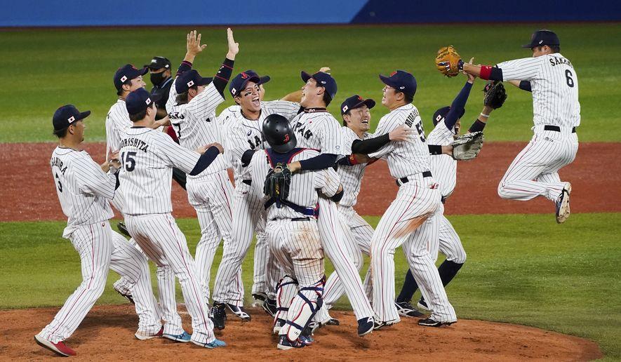 Team Japan celebrate after the gold medal baseball game against the United States at the 2020 Summer Olympics, Saturday, Aug. 7, 2021, in Yokohama, Japan. Japan won 2-0. (AP Photo/Jae C. Hong)