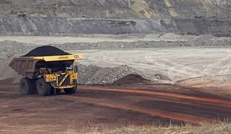 In this March 28, 2017, file photo, a dump truck hauls coal at Contura Energy's Eagle Butte Mine near Gillette, Wyo. (AP Photo/Mead Gruver) ** FILE **