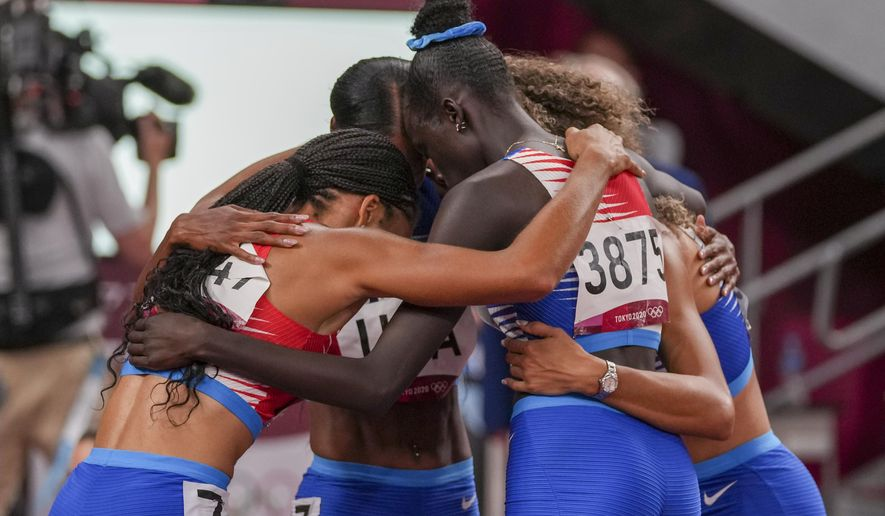 The team from the United States wins the women's 4 x 400-meter relay at the 2020 Summer Olympics, Saturday, Aug. 7, 2021, in Tokyo. (AP Photo/Matthias Schrader)