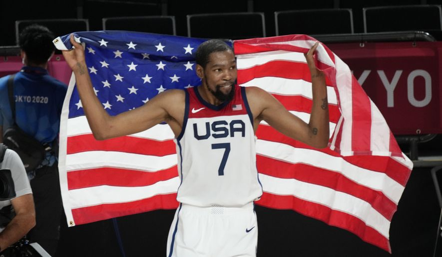 United States' Kevin Durant (7) celebrates after their win in the men's basketball gold medal game against France at the 2020 Summer Olympics, Saturday, Aug. 7, 2021, in Saitama, Japan. (AP Photo/Luca Bruno)