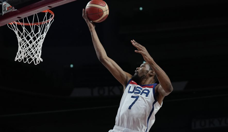 United States' Kevin Durant (7) scores during men's basketball gold medal game against France at the 2020 Summer Olympics, Saturday, Aug. 7, 2021, in Saitama, Japan. (AP Photo/Eric Gay)