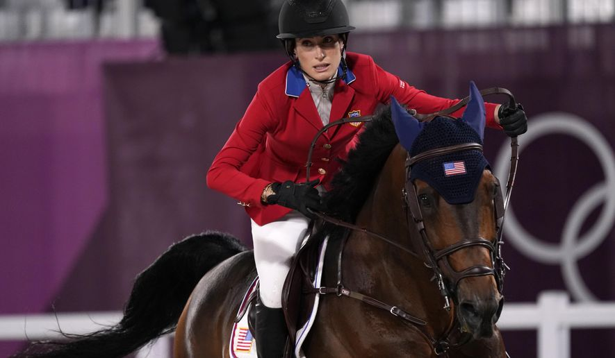 United States' Jessica Springsteen, riding Don Juan van de Donkhoeve, competes in a jump-off during the equestrian jumping team final at Equestrian Park in Tokyo at the 2020 Summer Olympics, Saturday, Aug. 7, 2021, in Tokyo, Japan. (AP Photo/Carolyn Kaster)