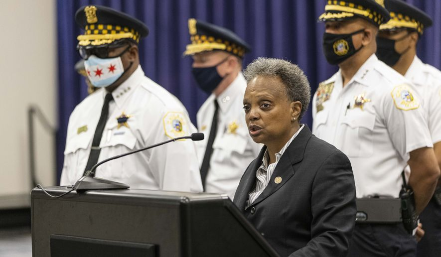 Mayor Lori Lightfoot speaks about the shooting of two police officers during a press conference at the Chicago Police Headquarters in Bronzeville to address the overnight shooting of two police officers during a traffic stop in West Englewood, Sunday, Aug. 8, 2021. (Anthony Vazquez/Chicago Sun-Times via AP)