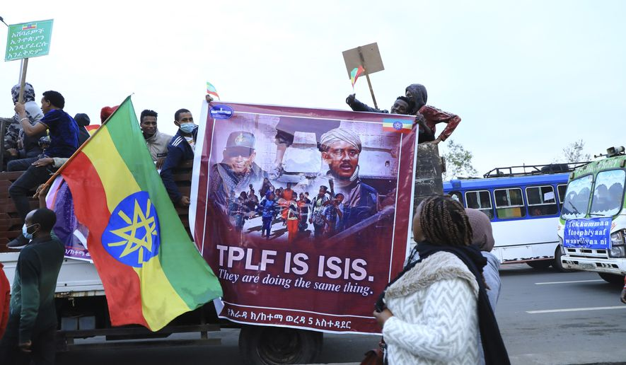 """Thousands of Ethiopian from the capital, Addis Ababa and the environs are flocking to Meskel Square, Sunday, Aug. 8, 2021, to rally against the TPLF under the motto """"I march to Save Ethiopia"""" and renew committment to support the national army. Horsemen from towns and villages of the outskirts of Addis Ababa and Finfine Special zone are riding to the most famous public Square saying slogans denouncing the TPLF atrocities and praising bravery of the troops of the Ethiopian National Defence Forces (ENDF). (AP Photo)"""