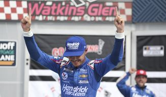 Kyle Larson celebrates winning a NASCAR Cup Series auto race in Watkins Glen, N.Y., on Sunday, Aug. 8, 2021. (AP Photo/Joshua Bessex)