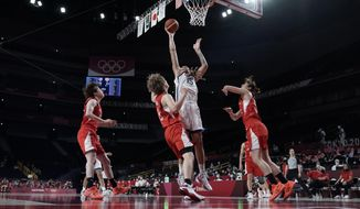United States' Brittney Griner (15) shoots over Japan's Maki Takada (8) during women's basketball gold medal game at the 2020 Summer Olympics, Sunday, Aug. 8, 2021, in Saitama, Japan. (AP Photo/Eric Gay)