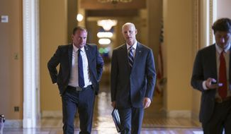 Sen. Mike Lee, R-Utah, left, and Sen. Rick Scott, R-Fla., leave a meeting in the office of Senate Minority Leader Mitch McConnell, R-Ky., as a coalition of Democrats and Republicans push the $1 trillion bipartisan infrastructure package closer to passage despite a few holdouts trying to derail one of President Joe Biden's top priorities, at the Capitol in Washington, Monday, Aug. 9, 2021. (AP Photo/J. Scott Applewhite)