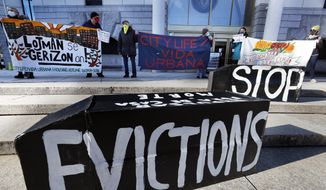 In this Jan. 13, 2021, file photo, tenants' rights advocates demonstrate in front of the Edward W. Brooke Courthouse in Boston. (AP Photo/Michael Dwyer, File)