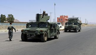 Afghan security personnel patrol after they took back control of parts of the city of Herat following fighting between Taliban and Afghan security forces, on the outskirts of Herat, 640 kilometers (397 miles) west of Kabul, Afghanistan, Sunday, Aug. 8, 2021. (AP Photo/Hamed Sarfarazi)