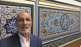 Abolfazl Nahidian, of the Manassas Mosque in Manassas, Va., poses after after a press conference, Tuesday, Aug. 10, 2021, in which he and other Muslim leaders asked the Biden administration to release a set of religious tiles that have been confiscated because the shipment was considered a violation of sanctions on Iran. (AP PhotoMatt Barakat)