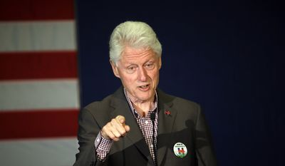 In this photo taken May 5, 2016, former President Bill Clint speaks in Portland, Ore. while campaigning for his wife, Democratic presidential candidate Hillary Clinton.  Newly released records show the scandal-plagued former president had withdrawn his approval for a teaching chair to be named after himself at the University of Arkansas's William H. Bowen School of Law. Yet emeritus professor John DiPippa, who has held the post since it was first endowed in 2000, recently dubbed it the Clinton chair anyway. (AP Photo/Don Ryan)  **FILE**