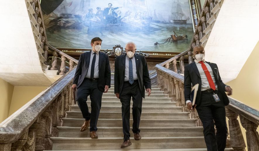 Senate Budget Committee Chairman Bernie Sanders, I-Vt., center, walks towards the Senate floor as the Senate moves from passage of the infrastructure bill to focus on a massive $3.5 trillion budget resolution, a blueprint of President Joe Biden's top domestic policy ambitions, at the Capitol in Washington, Tuesday, Aug. 10, 2021. (AP Photo/Andrew Harnik)