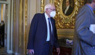 Senate Budget Committee Chairman Bernie Sanders, I-Vt., arrives as the Senate moves from passage of the infrastructure bill to focus on a massive $3.5 trillion budget resolution, a blueprint of President Joe Biden's top domestic policy ambitions, at the Capitol in Washington, Tuesday, Aug. 10, 2021. (AP Photo/J. Scott Applewhite)