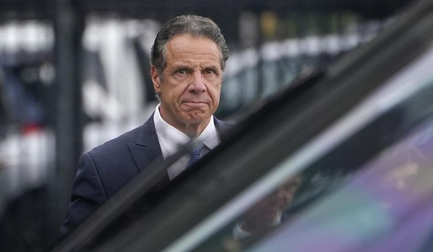 New York Gov. Andrew Cuomo prepares to board a helicopter after announcing his resignation, Tuesday, Aug. 10, 2021, in New York. Cuomo says he will resign over a barrage of sexual harassment allegations. The three-term Democratic governor's decision, which will take effect in two weeks, was announced Tuesday as momentum built in the Legislature to remove him by impeachment. (AP Photo/Seth Wenig)