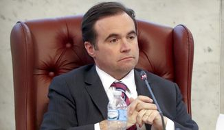 In this March 21, 2018, file photo, Cincinnati Mayor John Cranley listens during a city council meeting in Cincinnati. Cranley has made it official: He's running to be governor of Ohio. With the launch of his campaign, he joins his friend, Dayton Mayor Nan Whaley, in the Democratic field. (AP Photo/John Minchillo, File)