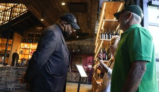 Security personnel ask customers for proof of vaccination as they enter City Winery, Thursday, June 24, 2021, in New York. Mayor Bill de Blasio announced Tuesday that later this month the city will begin requiring anyone dining indoors at a restaurant, working out a gym or grabbing cocktails at a bar to show proof they've been inoculated. (AP Photo/Frank Franklin II, File)