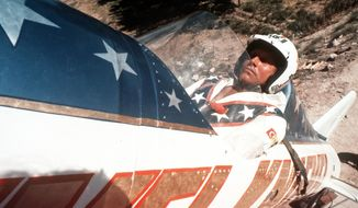 FILE - In this Sept. 8, 1974, file photo, Evel Knievel sits in the steam-powered rocket motorcycle that will hopefully take him across Snake River Canyon in Twin Falls, Idaho.  (AP Photo, File)