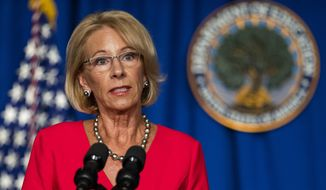 In this July 8, 2020, photo, then-Education Secretary Betsy DeVos speaks during a briefing at the Department of Education building in Washington. (AP Photo/Manuel Balce Ceneta) **FILE**