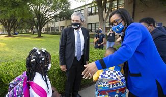Dallas Independent School District Superintendent Michael Hinojosa and Dallas Mavericks CEO Cynt Marshall welcome students on the first day of school at Adelle Turner Elementary School in Dallas, Monday, Aug. 9, 2021. (Brandon Wade/The Dallas Morning News via AP) ** FILE **