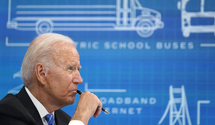 President Joe Biden listens during a virtual meeting from the South Court Auditorium at the White House complex in Washington, Wednesday, Aug. 11, 2021, to discuss the importance of the bipartisan Infrastructure Investment and Jobs Act. (AP Photo/Susan Walsh)