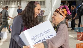 Yael Eckstein, president and CEO of the International Fellowship of Christians & Jews, speaks with an elderly Jewish aid recipient in Israel. (Photo courtesy of International Fellowship of Christians & Jews)