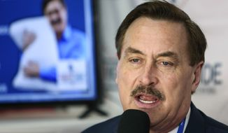 MyPillow founder and CEO Mike Lindell gives an interview with Right Side Broadcasting Network at the Conservative Political Action Conference in Orlando, Fla., on Feb. 28, 2021. A federal judge cleared the way Wednesday, Aug. 11 for a defamation case by Dominion Voting Systems to proceed against Trump allies Lindell, Sidney Powell and Rudy Giuliani, who had all falsely accused the company of rigging the 2020 presidential election. U.S. District Judge Carl Nichols handed down a ruling Wednesday that found there was no blanket protection on political speech. (Sam Thomas/Orlando Sentinel via AP) **FILE**