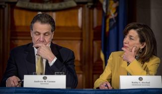 In this Wednesday, Feb. 25, 2015, file photo, Lt. Gov. Kathy Hochul looks toward New York Gov. Andrew Cuomo during a cabinet meeting at the Capitol in Albany, N.Y. Hochul is preparing to take the reins of power after Cuomo announced Tuesday, Aug. 10, 2021, that he would resign from office amid allegations that he sexually harassed several women. Cuomo denies touching anyone inappropriately. (AP Photo/Mike Groll, File)  **FILE**
