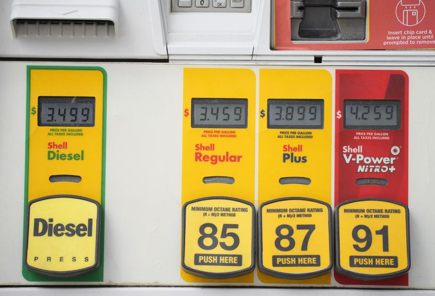 Prices top the various grades of fuel available from a pump at a Shell station Thursday, July 22, 2021, in southeast Denver. Colorado motorists are facing some of the highest prices per gallon of fuel in more than a decade. (AP Photo/David Zalubowski)