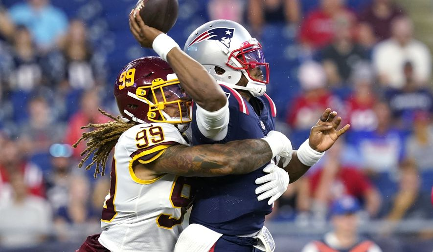 New England Patriots quarterback Cam Newton, right, is sacked by Washington Football Team defensive end Chase Young (99) during the first quarter of a preseason NFL football game Thursday, Aug. 12, 2021, in Foxborough, Mass. (AP Photo/Elise Amendola)
