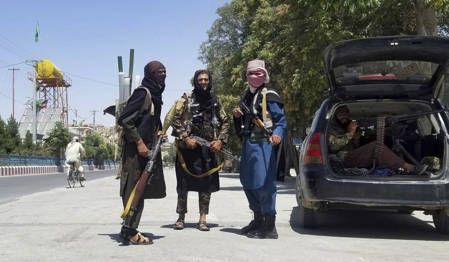 Taliban fighters pose for a photo as they patrol inside the city of Ghazni, southwest of Kabul, Afghanistan, Thursday, Aug. 12, 2021. The Taliban captured the provincial capital near Kabul on Thursday, the 10th the insurgents have taken over a weeklong blitz across Afghanistan as the U.S. and NATO prepare to withdraw entirely from the country after decades of war. (AP Photo/Gulabuddin Amiri)