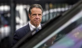 In this Tuesday, Aug. 10, 2021, file photo, New York Gov. Andrew Cuomo prepares to board a helicopter after announcing his resignation in New York. Sexual harassment allegations cost Cuomo his job. Now, many want to see him answer for a scandal that cut to the heart of his reputation as a pandemic hero and had life-and-death consequences — his handling of outbreaks in nursing homes. (AP Photo/Seth Wenig, File)