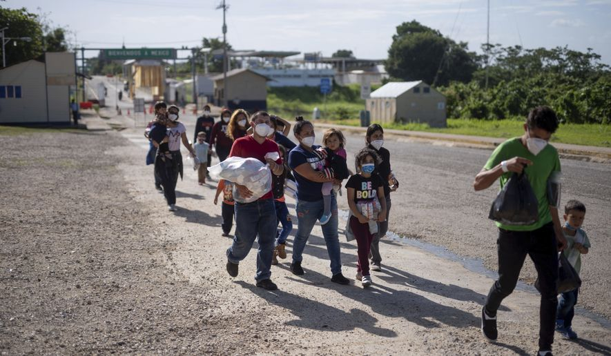 Central American asylum-seekers arrive at El Ceibo, Guatemala, Thursday, Aug. 12, 2021, after being deported by air from the U.S. to Mexico and then shipped into Guatemala by land. The Central American migrants were expelled by the U.S. after being denied a chance to seek asylum under a pandemic-related ban. (AP Photo/Santiago Billy) **FILE**