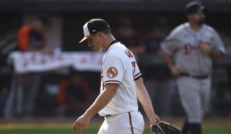 Baltimore Orioles pitcher John Means walks to the dugout after giving up five runs to the Detroit Tigers during the fourth inning of a baseball game Thursday, Aug. 12, 2021, in Baltimore.(AP Photo/Gail Burton)