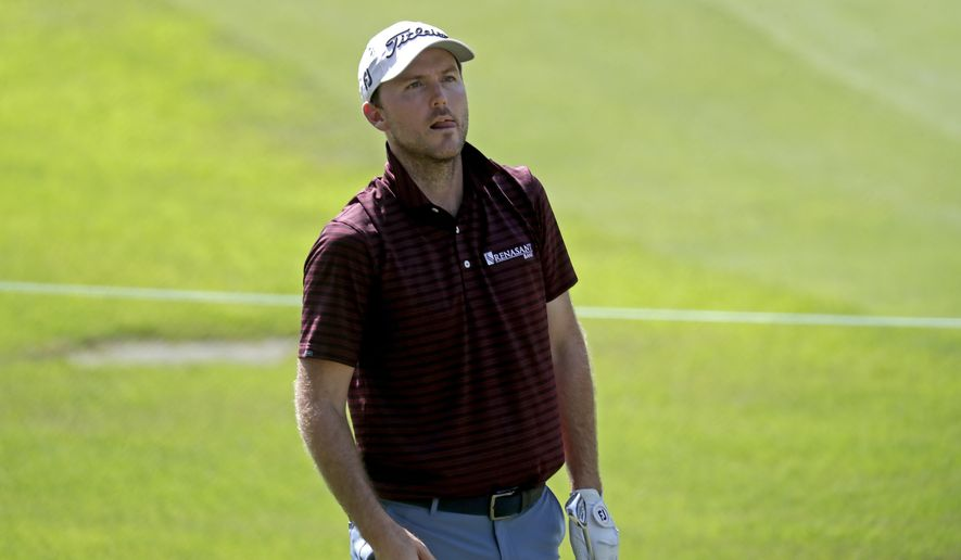 Russell Henley looks to see where his ball landed after he hit out of the rough on the ninth hole during the first round of the Wyndham Championship golf tournament at Sedgefield Country Club in Greensboro, N.C. on Thursday, Aug. 12, 2021. (AP Photo/Chris Seward)