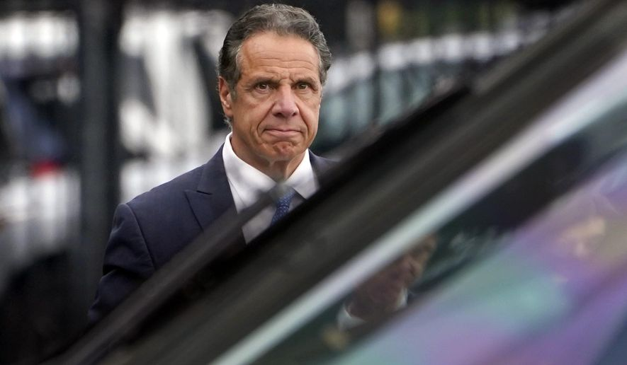 FILE - In this Tuesday, Aug. 10, 2021 file photo file photo, New York Gov. Andrew Cuomo prepares to board a helicopter after announcing his resignation in New York. Sexual harassment allegations cost Cuomo his job. Now, many want to see him answer for a scandal that cut to the heart of his reputation as a pandemic hero and had life-and-death consequences — his handling of outbreaks in nursing homes. (AP Photo/Seth Wenig, File)