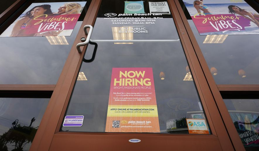 """A """"Now Hiring"""" sign is shown at a business in Richmond, Va., on Wednesday, June 2, 2021. (AP Photo/Steve Helber) ** FILE **"""
