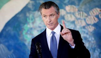 California Gov. Gavin Newsom speaks during a news conference at Carl B. Munck Elementary School, Wednesday, Aug. 11, 2021, in Oakland, Calif. Newson announced California will become the first state in the nation to require all teachers and school staff to get vaccinated or undergo weekly COVID-19 testing, as schools return from summer break amid growing concerns about the highly contagious delta variant.  (Santiago Mejia/San Francisco Chronicle via AP) **FILE**