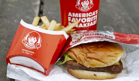 FILE - In this May 5, 2020, file  photo, Wendy's restaurant Dave's Combo cheeseburger meal is displayed in Pittsburgh. Wendy's plans to open 700 delivery-only kitchens by 2025 to meet the growing demand from people who want their fast food brought to them. The kitchens will primarily operate in urban neighborhoods in the U.S., Canada and the United Kingdom, the company said. (AP Photo/Gene J. Puskar, File)