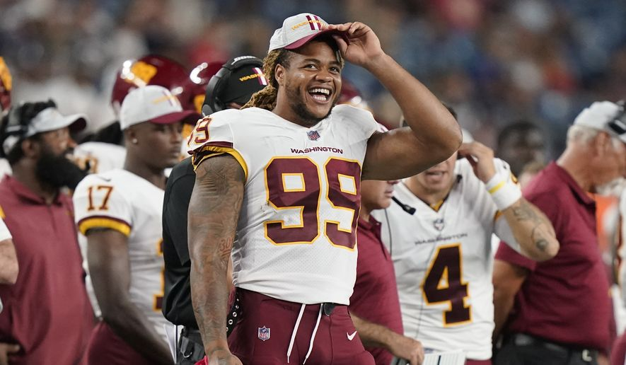 Washington Football Team defensive end Chase Young (99) during the second half of a preseason NFL football game, Thursday, Aug. 12, 2021, in Foxborough, Mass. (AP Photo/Steven Senne)
