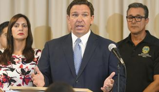 Florida Governor Ron DeSantis answers questions related to school openings and the wearing of masks, Tuesday, Aug. 10, 2021, in Surfside, Fla. (AP Photo/Marta Lavandier)