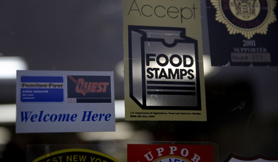 FILE - In this Jan. 12, 2015 file photo, a supermarket displays stickers indicating they accept food stamps in West New York, N.J. The Biden administration has approved a significant and permanent increase in the levels of food stamp assistance available to needy familiesthe largest single increase in the programs history. Starting in October 2021, average benefits for food stamps (officially known as the SNAP program) will rise more than 25 percent above pre-pandemic levels. (AP Photo/Seth Wenig, File)