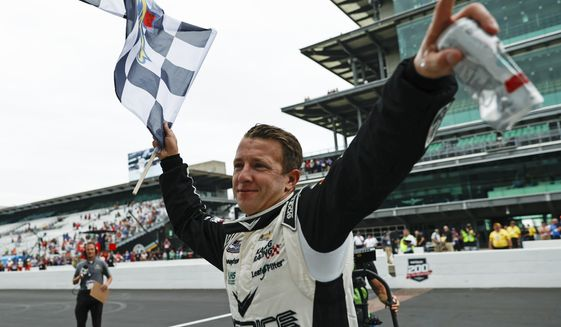 AJ Allmendinger celebrates after winning a NASCAR Series auto race at Indianapolis Motor Speedway, Sunday, Aug. 15, 2021, in Indianapolis. (AP Photo/Rob Baker)