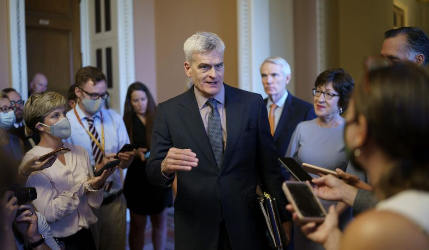 Sen. Bill Cassidy, R-La., center, and other Senate Republicans negotiating a $1 trillion infrastructure bill with Democrats, announce they have reached agreement on the major outstanding issues and are ready to vote to take up the bill, at the Capitol in Washington, Wednesday, July 28, 2021. (AP Photo/J. Scott Applewhite)
